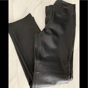 Black leather pants .